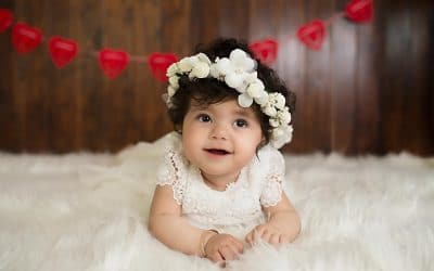 smiling baby white headbend