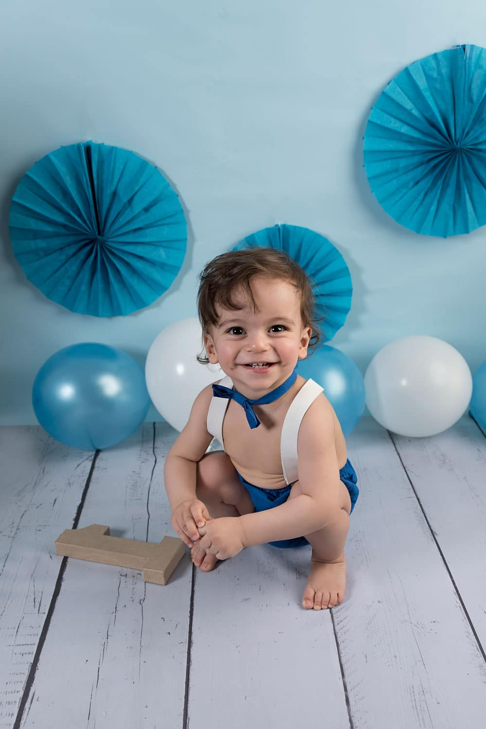 sitting baby with blue decoration