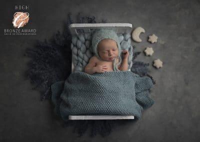 little baby boy in bed