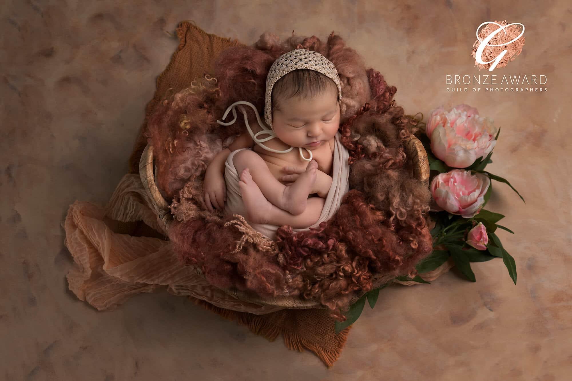 newborn baby girl with flowers