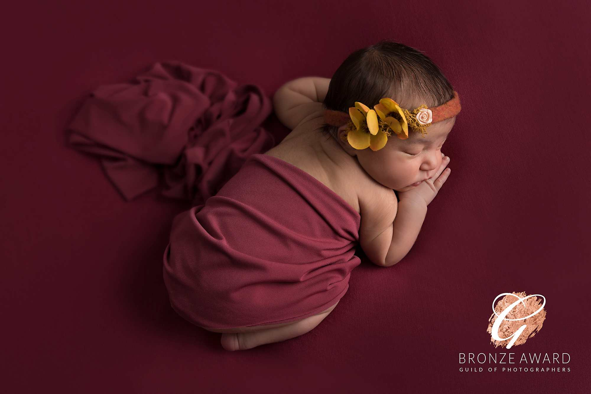 newborn girl in purple wrap