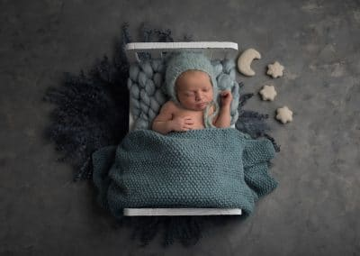 newborn baby teddy in bed with stars