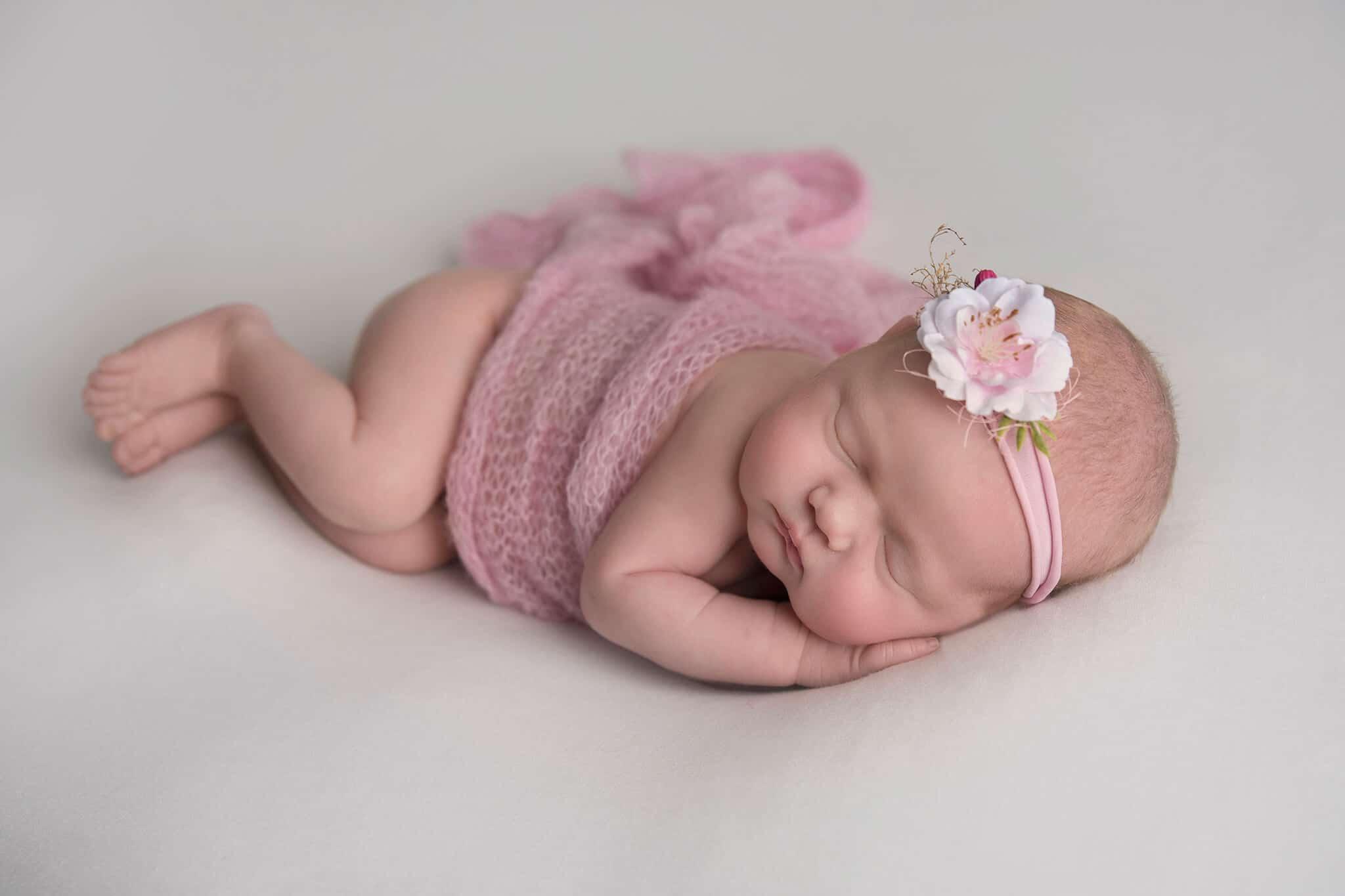sleeping newborn baby girl on white blanket by Newborn Photographer Cheshire