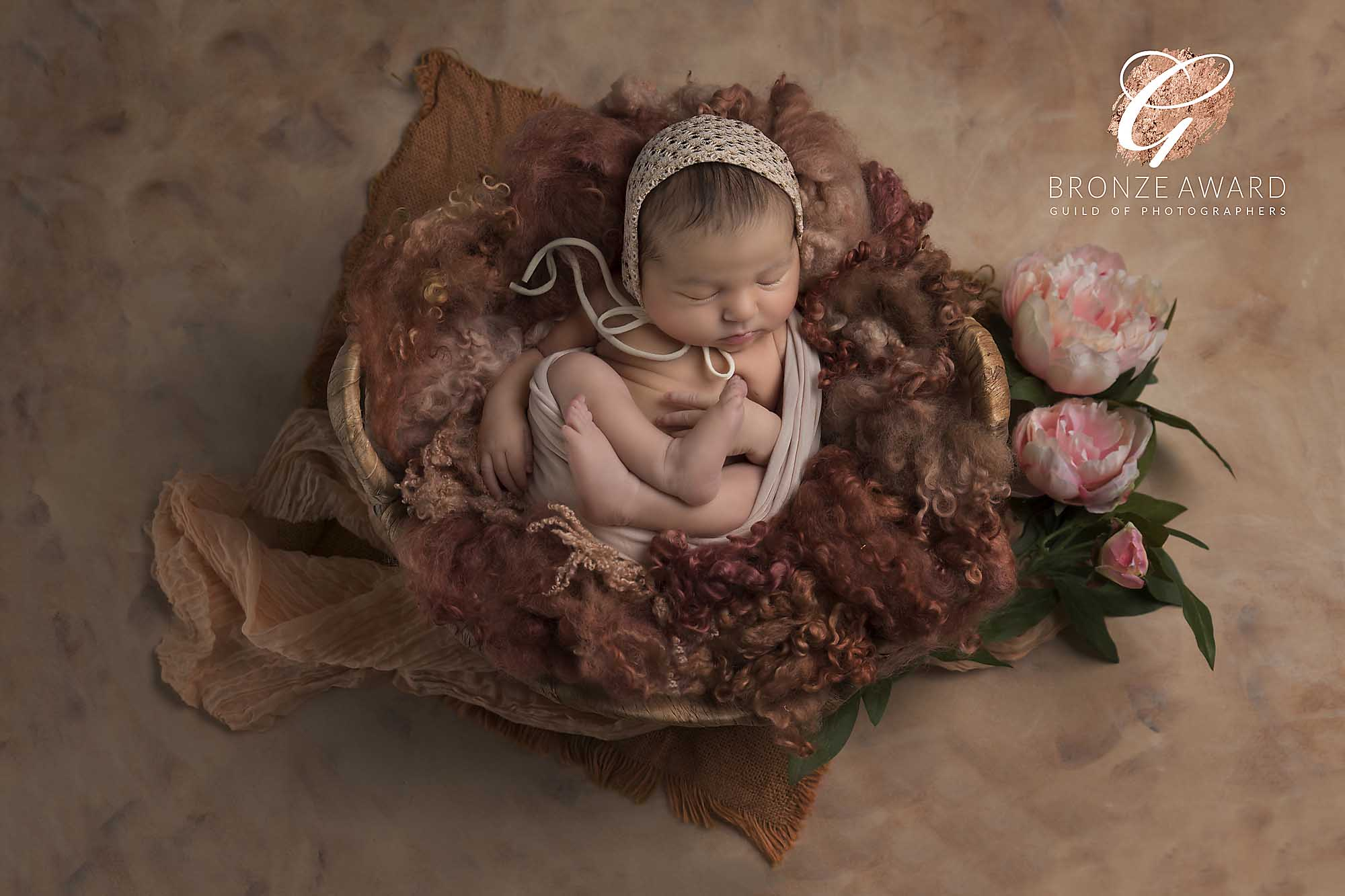 newborn baby girl in a basket and flowers photographed by Newborn Photographer Manchester