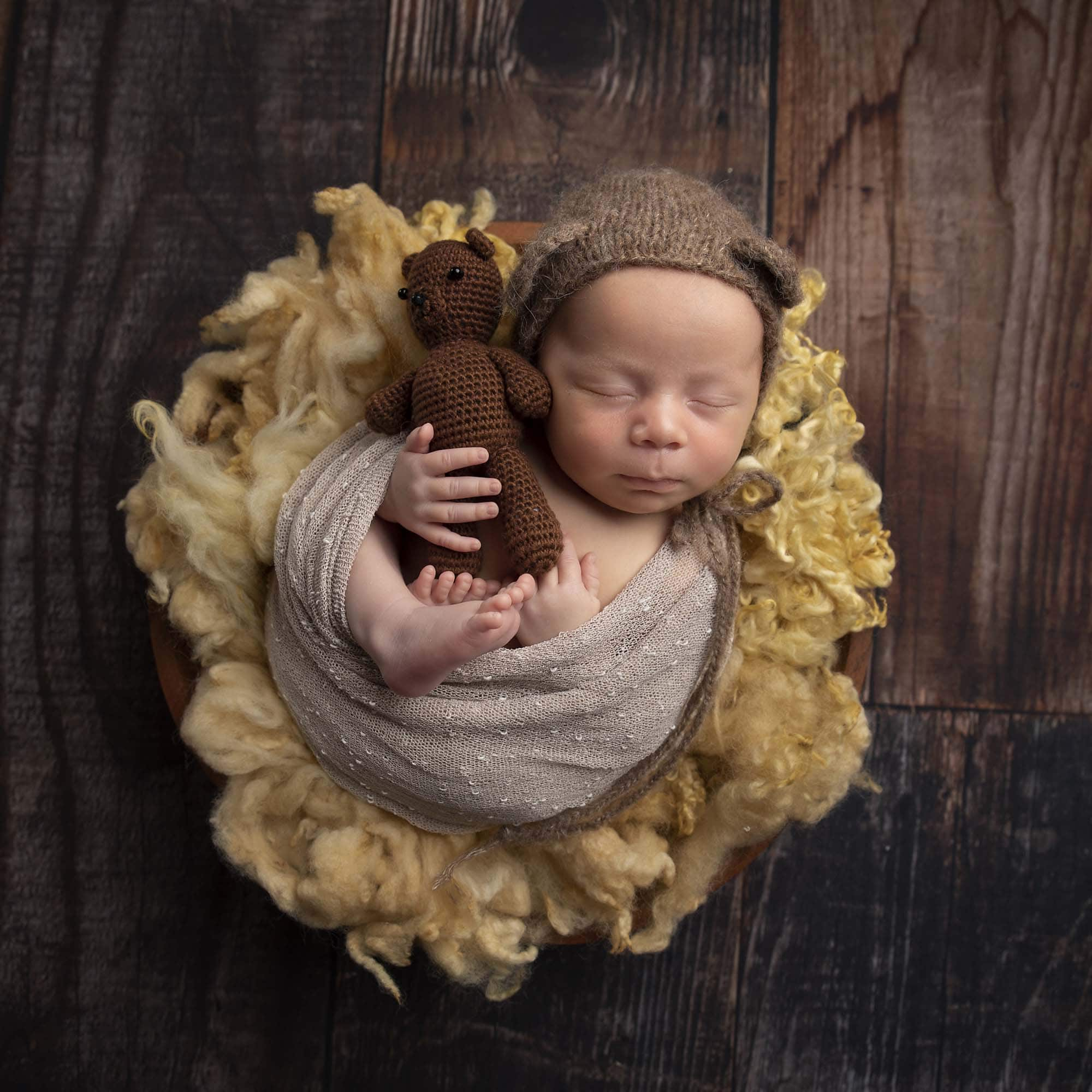 newborn boy with teddy toy in basket photographed by Newborn Photographer Cheshire