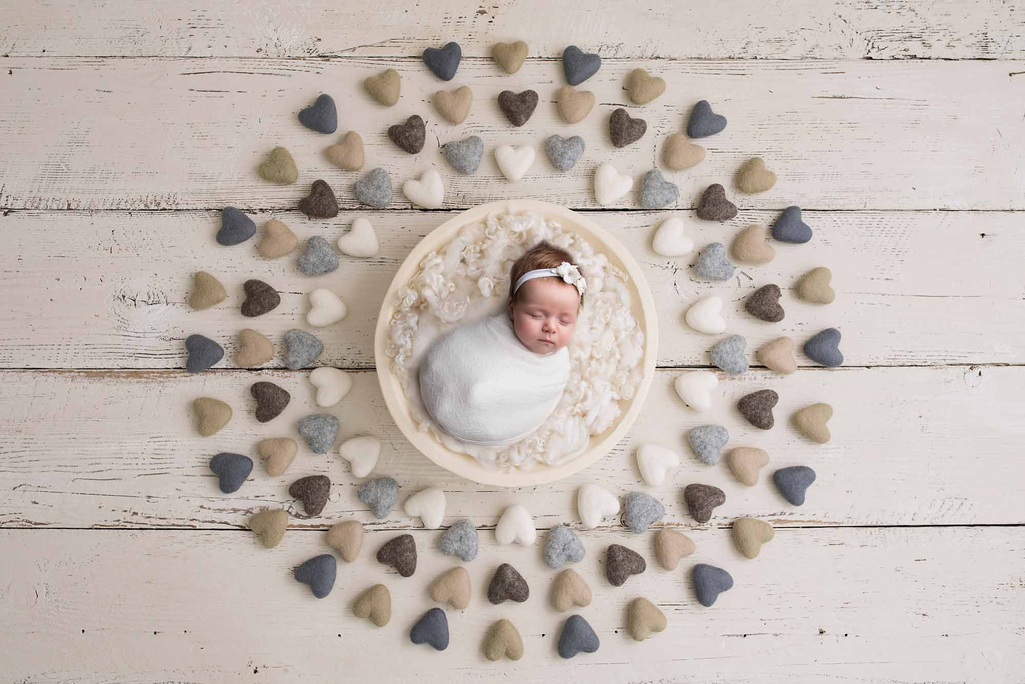 newborn girl with lots of hearts photographed by Newborn Photographer Cheshire
