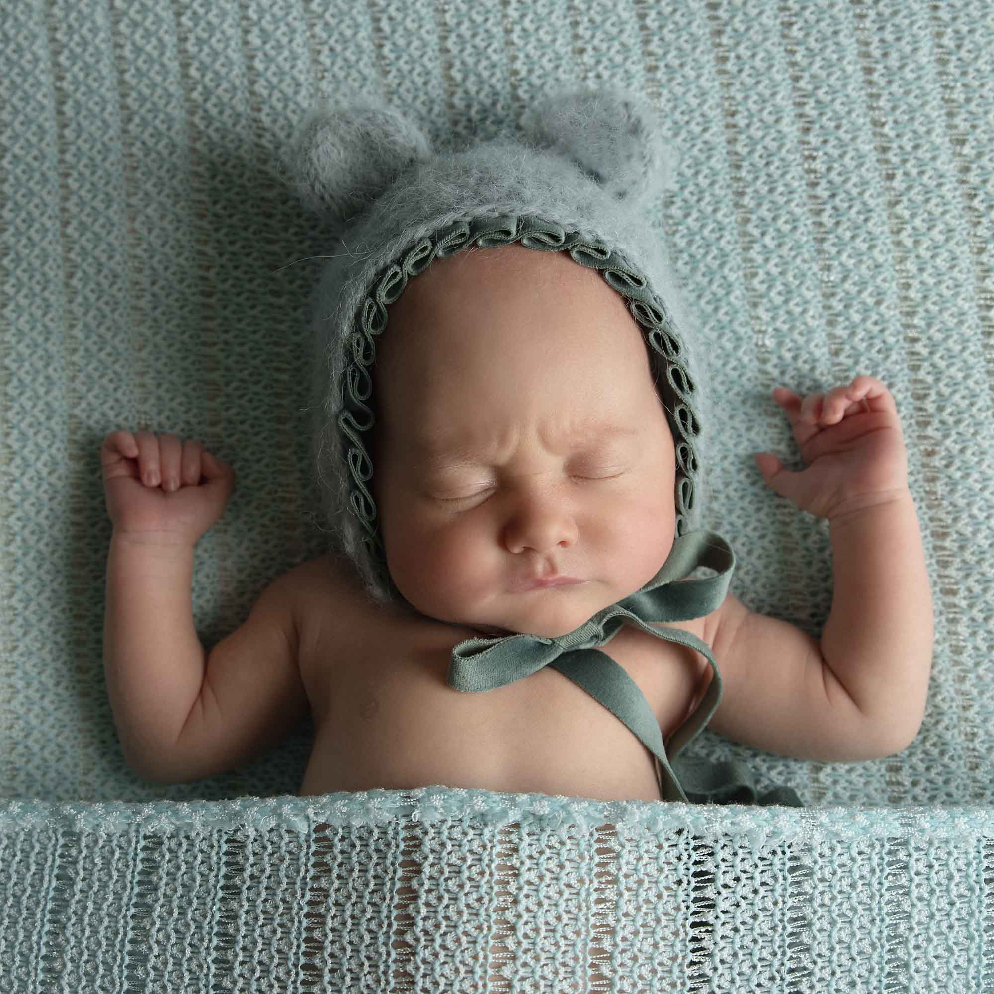 newborn boy with mint teddy hat photographed by Newborn Photographer Cheshire