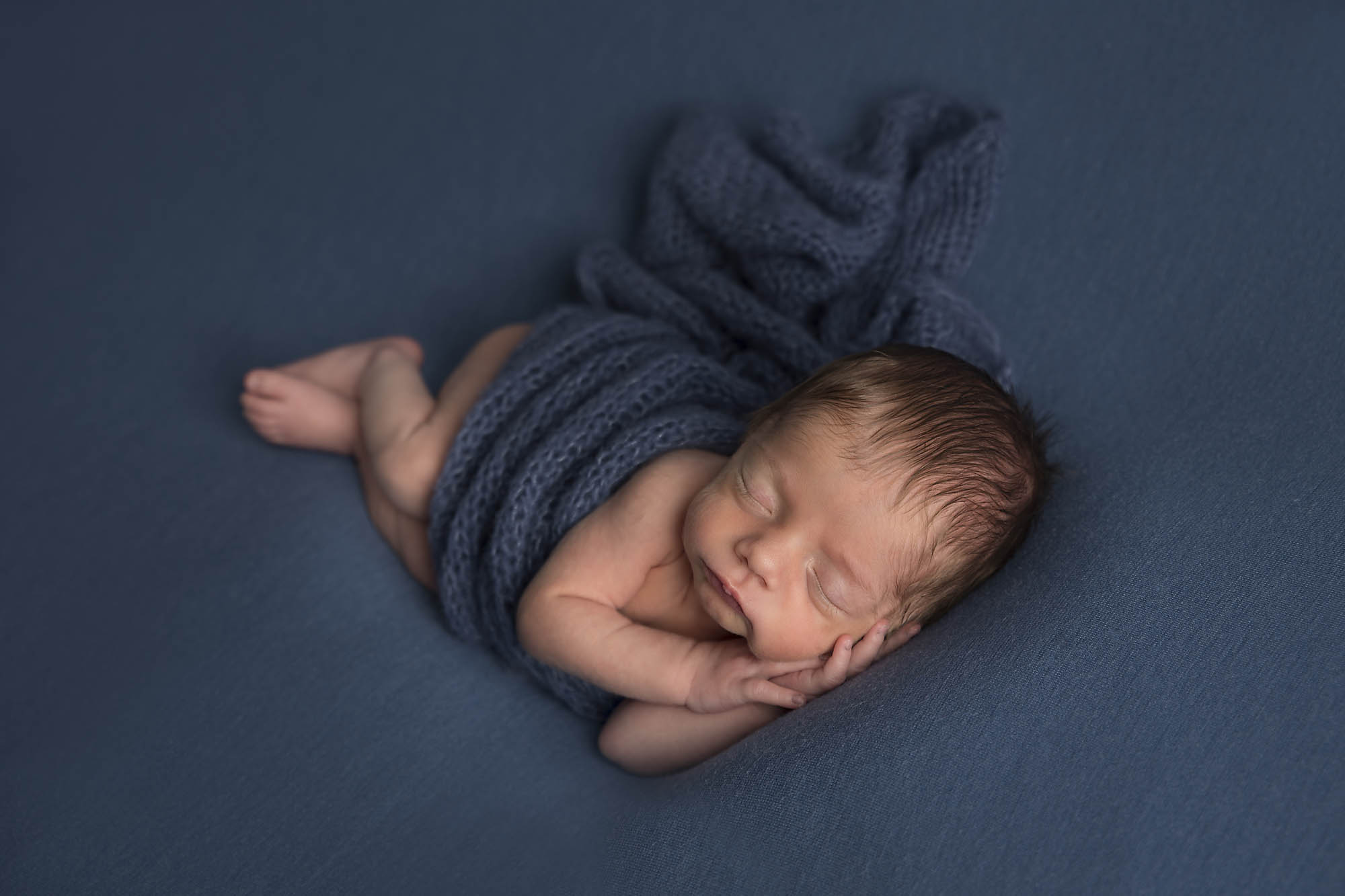 newborn baby boy on blue blanket photographed by Newborn Photographer Cheshire