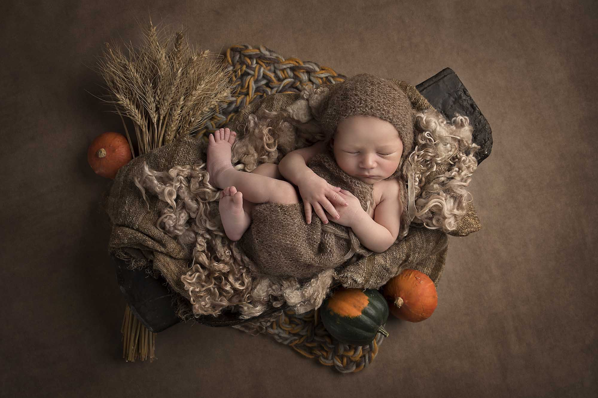 newborn baby with autumn set photographed by Newborn Photographer Cheshire