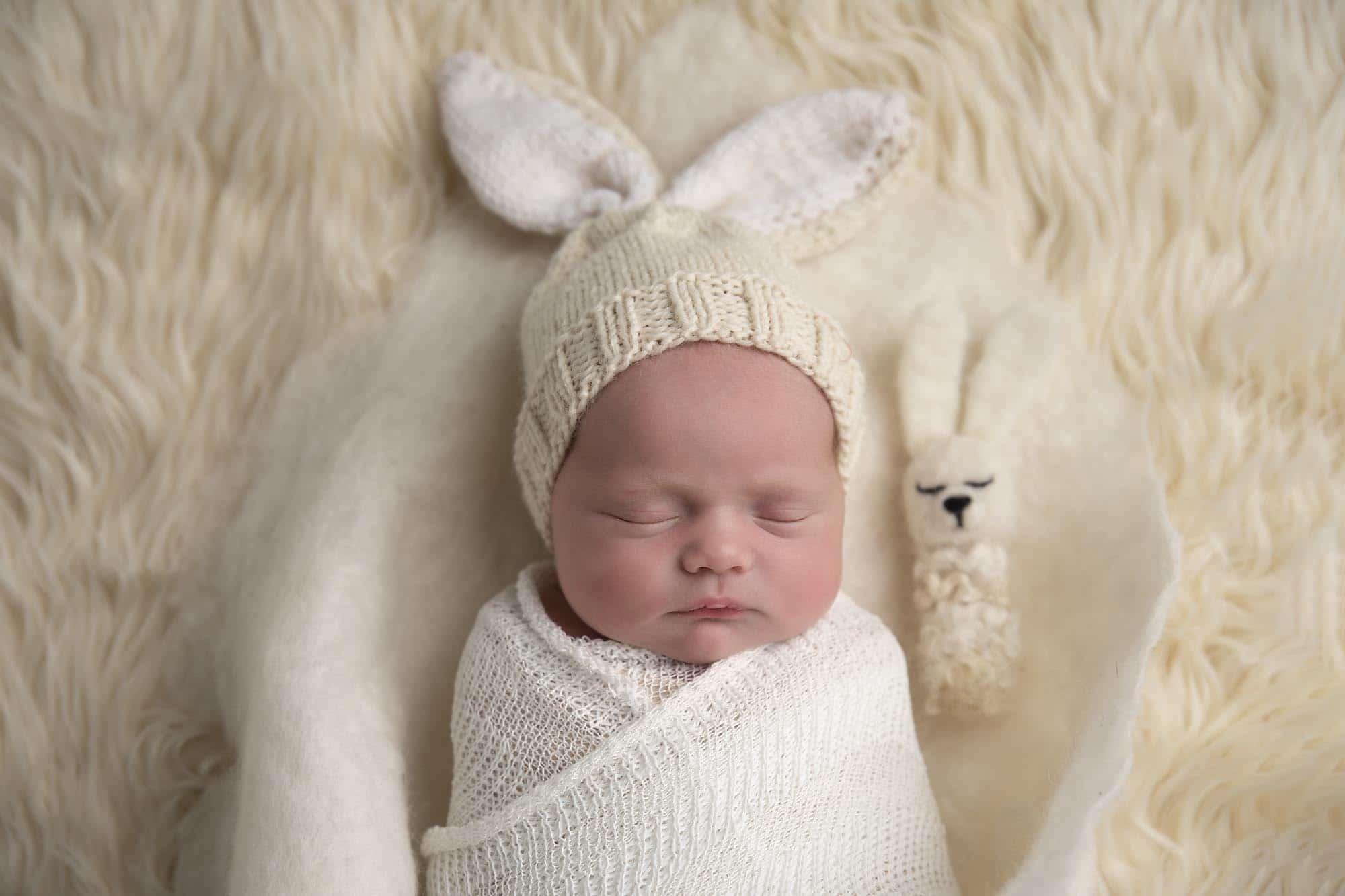 newborn girl in white bunny hat photographed by Newborn Photographer Cheshire