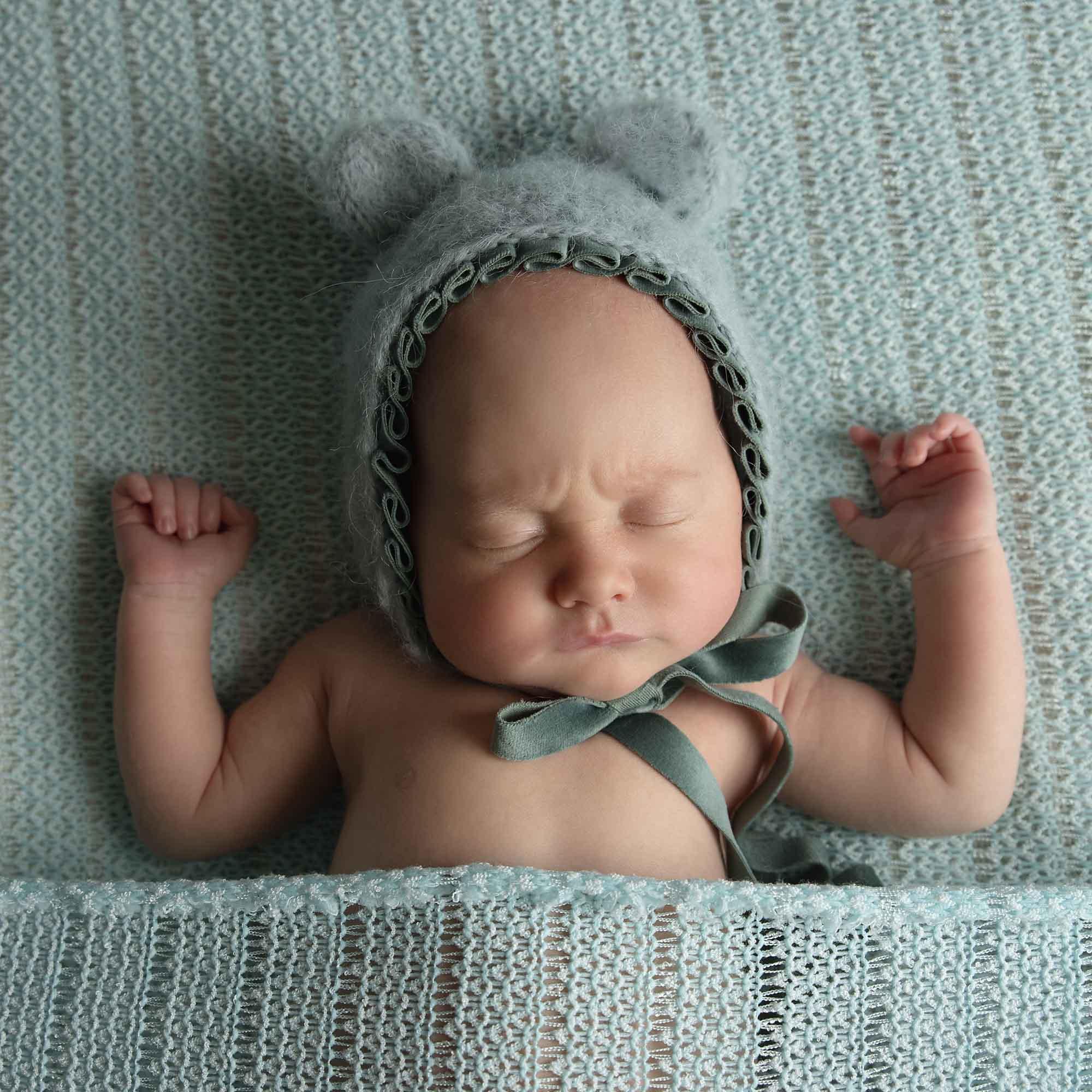 newborn baby boy in mint teddy set photographed by Newborn Photographer Cheshire