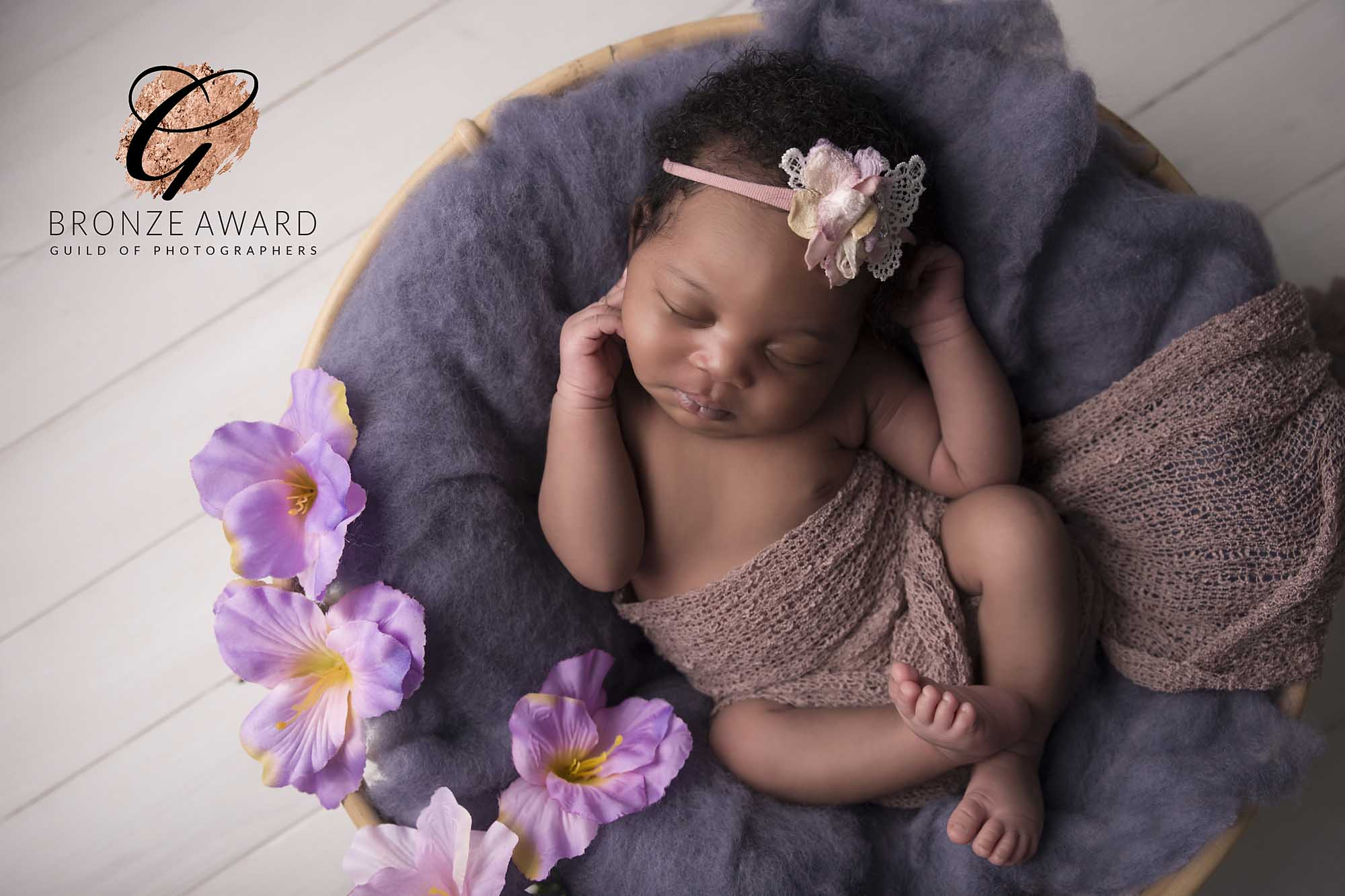 newborn girl with pink flowers photographed by Newborn Photographer Cheshire
