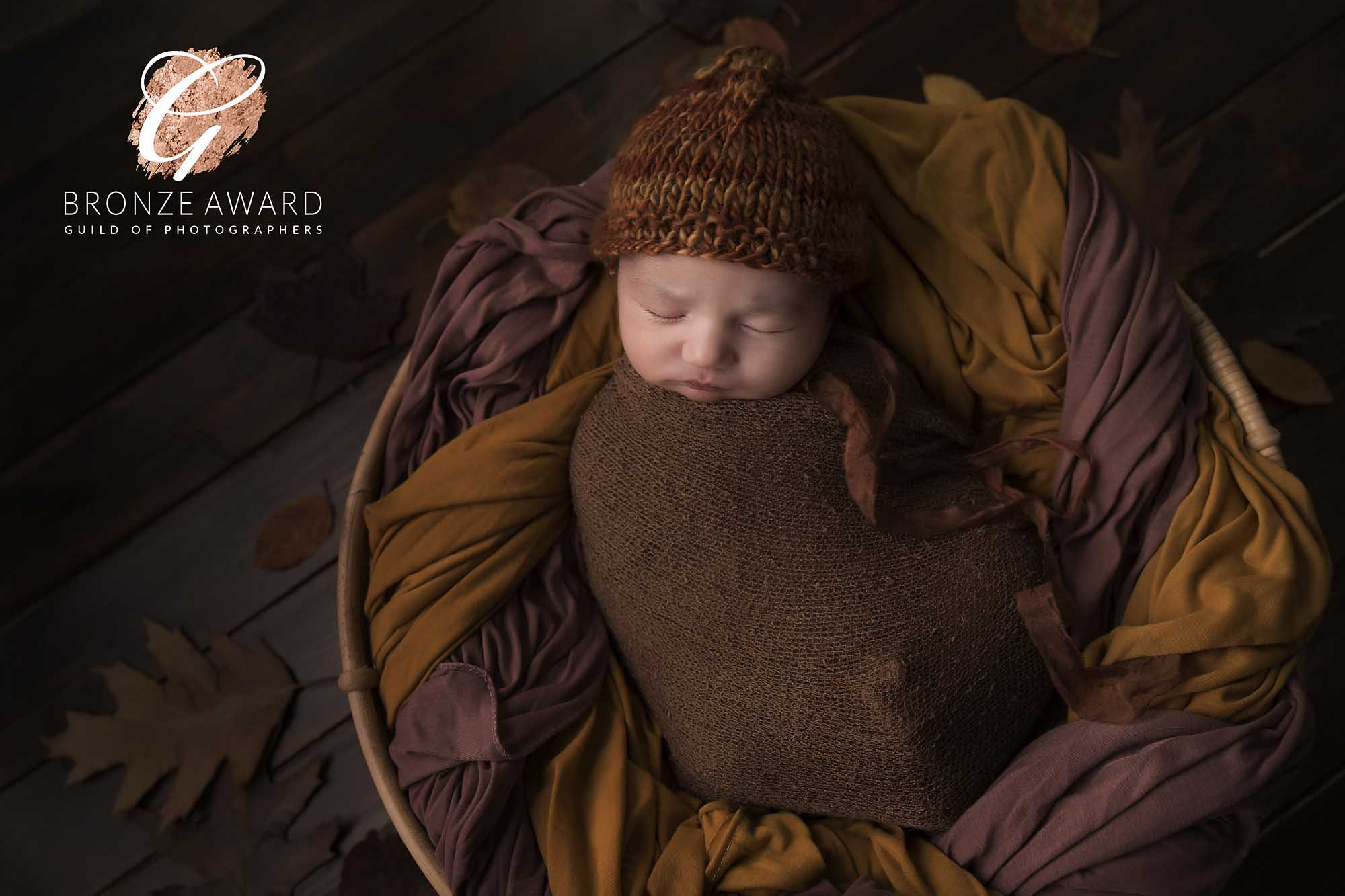 newborn boy with brown autumn decoration photographed by Newborn Photographer Cheshire