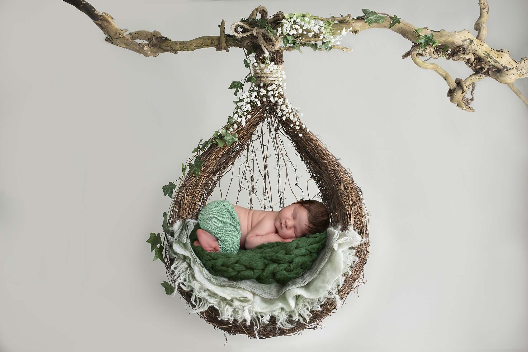 newborn boy with hanging basket photographed by Newborn Photographer Cheshire