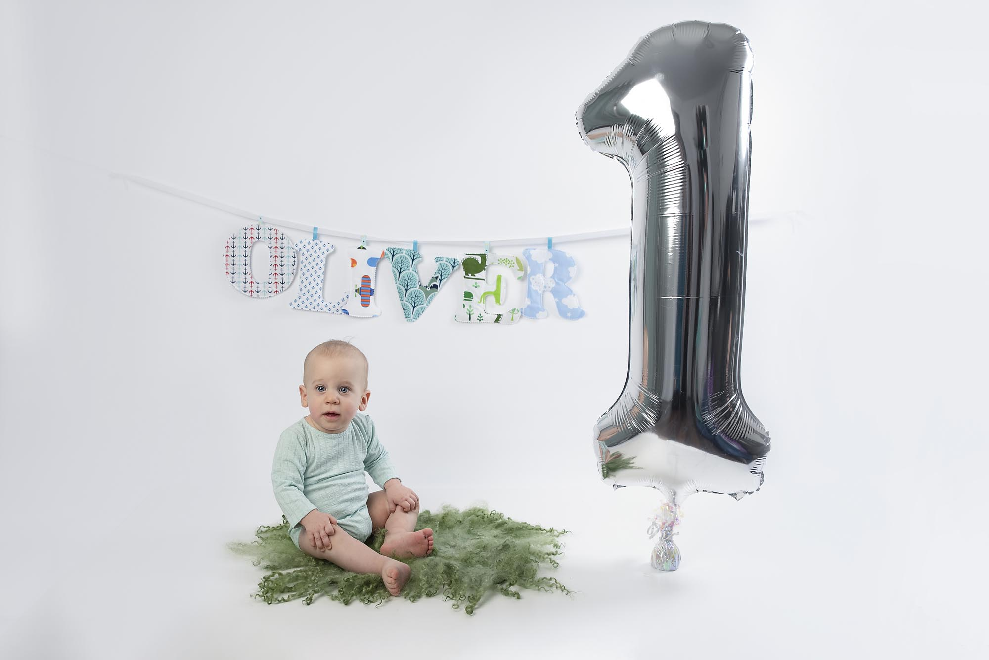 milestone photoshoot with one year old little boy and baloon photographed by cake smash photography Manchester