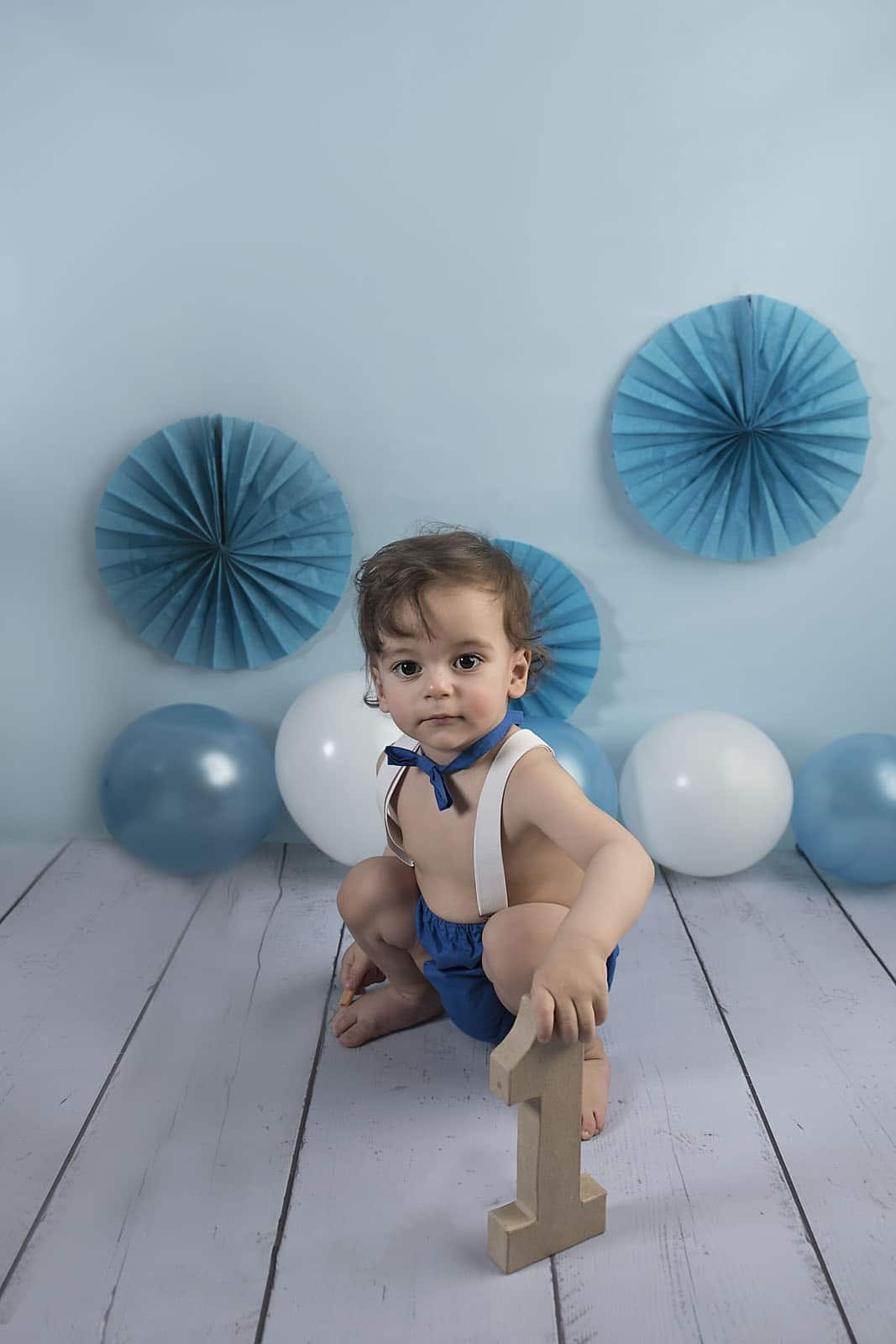 one year old baby boy photoshoot photographed by cake smash photography Manchester