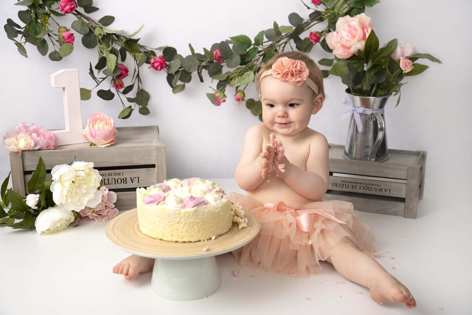 cakesmash photoshoot with one year old little girl and cake photographed by cake smash photography Manchester