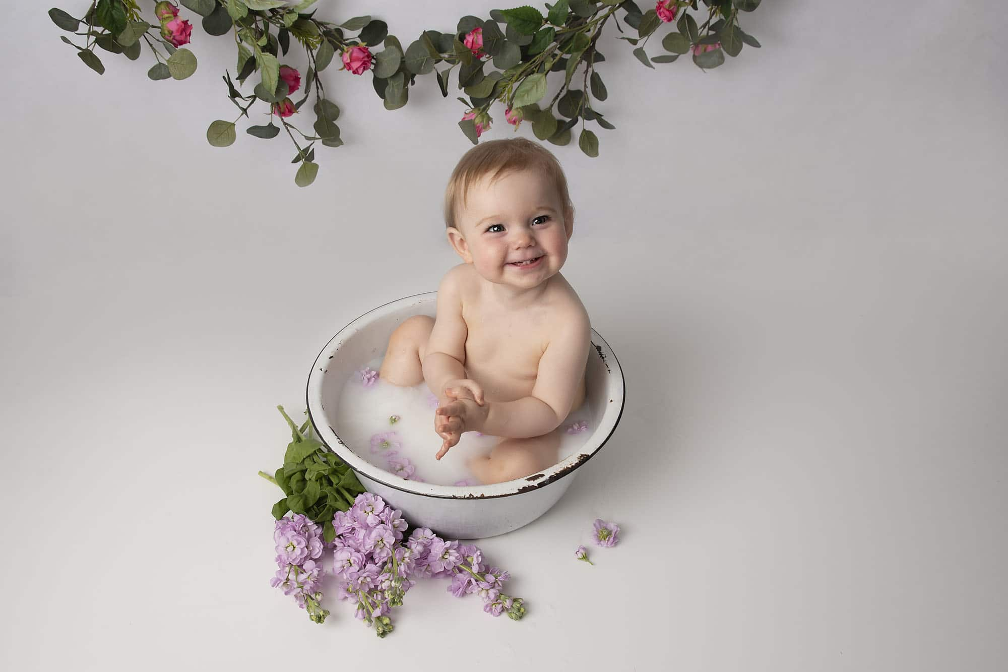 bath spash with little girl and flower decoration photographed by cake smash photography Manchester