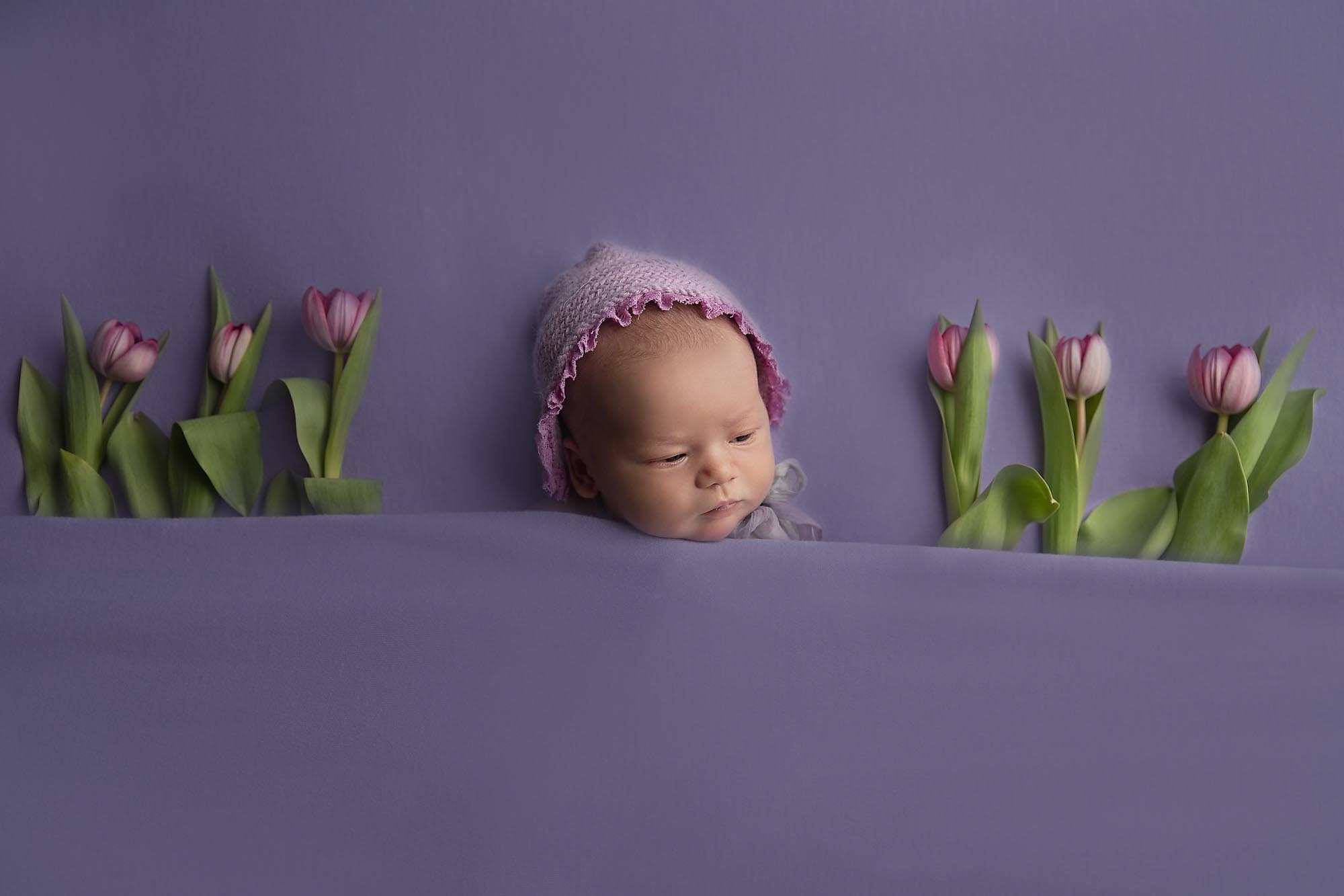 newborn baby with tulips taken by newborn photography Manchester