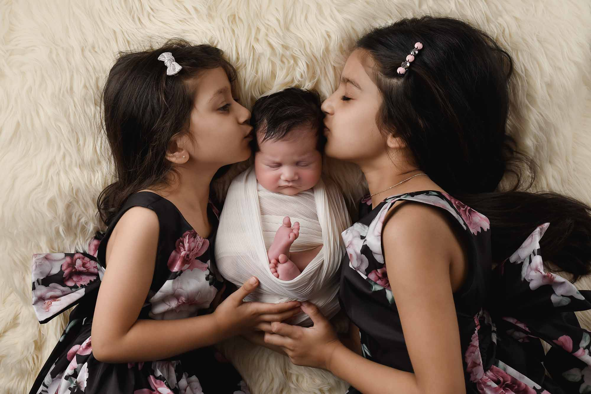 Siblings kissing little sister taken by family photography manchester